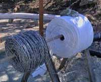 12.5 gauge, 4-point galvanized barbed wire, One Community